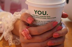 starbucks. perfectly applied manicure. great combination.