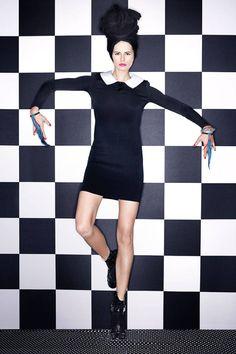 Carine Roitfeld's spring 2014 fashion shoot  Dress: Ralph Lauren Collection Bracelets: Prada and Cartier Boots: Louis Vuitton