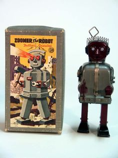Zoomer Robot vintage walking tin toy by NOMURA (Japan) 1950's. I have my father's Zoomer Robot in these exact colours, of dark red & grey, in great working condition, with his radar rachet. He walks & his eyes light up. I know he's worth over $2,000 U.S. but won't be selling. (please follow minkshmink on pinterest)