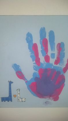 handprints. dad's, mom's and baby's