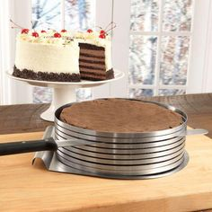 Our Baking Goods Cake Slicer is a MUST HAVE item for anyone who loves and enjoys baking! This cake slicer is the ideal tool for making round cakes. It's easy to expand or shrink the diameter of the rings so that you can make your cakes in a variety of different sizes! The Cake Slicer features an ingenious, solid back s