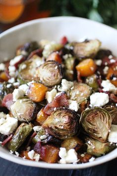 Honey Roasted Brussels Sprouts and Butternut Squash with Feta and Bacon will be the star of your holiday meal...or any weeknight meal for that matter! The sweetness of the honey and roasted vegetables pairs perfectly with the salty feta cheese and bacon making this dish a crowd pleaser every time!