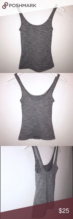 Lululemon Top Lululemon tank top. Grey size 4. I had this Top hemmed so the logo is missing from the bottom back. It is the same style as my other pink lululemon listing. Slightly worn, good condition. lululemon athletica Tops Tank Tops