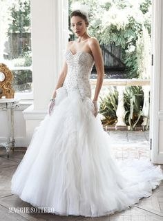 Glittering Swarovski crystals and pearls adorn the fitted bodice of this wedding dress, while dramatic folds of tulle and Chic organza create the stunning, voluminous skirt. Finished with sweetheart neckline and corset closure.  Maggie Sottero Bridal - 5MS668-Aliyah