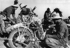Italian soldiers working on their  camo painted motorcycles