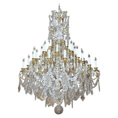 A fine important baccarat crystal chandelier in bronze dore and a fine important baccarat crystal chandelier in bronze dore and carved crystal chandeliers pinterest chandeliers contemporary lamps and pendants aloadofball Choice Image