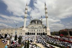 Worshippers offer their Friday prayers during the first Friday of the holy month of Ramadan before the opening ceremony of Mimar Sinan mosque in Istanbul July 20, 2012. REUTERS/Osman Orsal (TURKEYRELIGION SOCIETY - Tags: SOCIETY RELIGION)