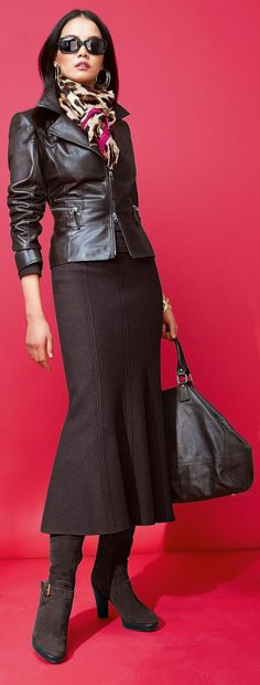 Madeleine; long brown skirt, flared at the knee; fitted leather jacket, suede boots