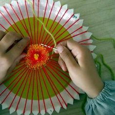 Paper plate weaving.