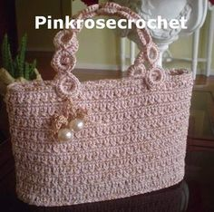 Pink bag crochet - For me this is *Inspiration* because the pattern is a jpg in another language so it can't be translated but there is also a diagram. Love the handles.