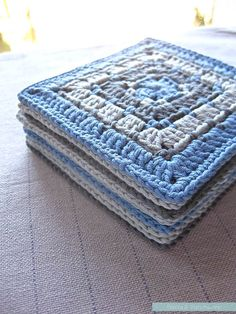 The blue #crochet squares all neatly stacked, post-blocking