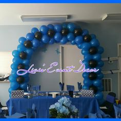 Blue and black balloon arch