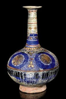 A LAJVARDINA POTTERY FLASK, NORTH IRAN, EARLY 14TH CENTURY