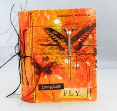 Altered book using Eileen Hull die and Prima products