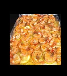 OMG Shrimp Preheat oven to 350 Plop 1 stick of butter on jelly roll pan and melt in oven.  Slice 1 lemon and put on top of melted butter.  Spread 2 pounds of shelled shrimp over lemons.  Sprinkle with garlic powder, Italian seasoning, salt & pepper.  Bake for 10 minutes.  I served with some rice flake that I purchased from the local asain market.  YUM!