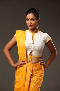 This contemporary take on the traditional rouka has buttons and a string tie at the front of the blouse. A quilted cream rouka with yellow edging gives it an. Saree Blouse Neck Designs, Fancy Blouse Designs, Saree Blouse Patterns, Choli Designs, Kerala, Style Oriental, Stylish Blouse Design, Beautiful Blouses, Indian Designer Wear