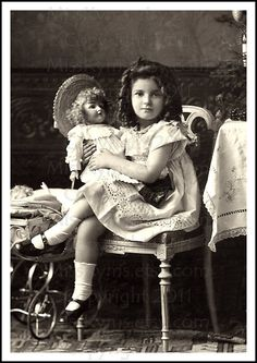 ~little girl with her doll