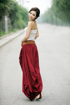 Make a statement day or night with this striking red maxi linen skirt. Team it with some heals and a strapless top for a really stylish party outfit. Whether youre going to a wedding party or a summer ball, you cannot go wrong with this skirt. It has a really elegant and sophisticated look which can be dressed up or down depending on the event you wish to attend. The hemline is asymmetrical in that it hangs right down to the floor at the back. This is a really full skirt with lots of fabric…