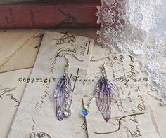 Rather pretty Small  Purple Faerie wing earrings by UndertheIvy2