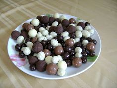 Hard little truffles in dark chocolate, milk chocolate, and white chocolate from Italy