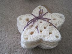 Free pattern for crochet star ornaments. I made some of these to put on hats and they were easy, quick and looked great!