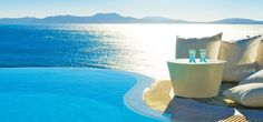 Mykonos Grand 5 Star Luxury Hotel & Resort offers a panoramic view of the blue Aegean sea and Delos.