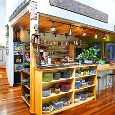 An Artist's Inspirational Kitchen -- i love those shelves - no wasted space!