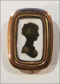 Silhouette Brooch. Silhouette Enhanced with Gold. Circa Early 19th Century.