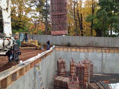 October 17th 2012 - The forms are being collected and removed from the basement. The construction crew is also back filling dirt around the foundation on the outside.