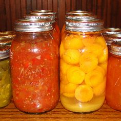 homemade tomato sauce and canned peaches (well, I think these are apricots) - great summer canning staples