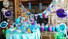 like this parties decorations :) hey, I already got the buckets for goody bags....just like these people have, great minds think alike...  Writing Our Story: An Under the Sea Mermaid Party!