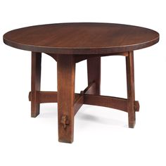 "Gustav Stickley library table, #636, thick circular top above splayed legs supported by arched cross-stretchers with key and tenon construction, ghost of a paper label and red decal, original finish to base, lightly recoated finish to top, 48""dia x 29.5""h"