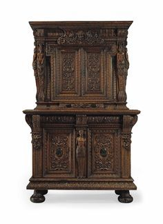 "French Renaissance Part I Armoire 'a duex corps-""...often has a pediment at the top and a frieze between the two sections featuring drawers"" (Ireland, glossary) This cabinet has two  parts: the bottom with the two doors and rounded feet and the top with drawers and decorative elements separating the two halves. This piece was popular in the ebony color wood which the French were famous for. A French protestant group known as the huguenots were especially skilled at wood carving. Ebony Color, Green Marble, Wood Carving, Armoire, Two By Two, Burgundy, Clock, Renaissance, Ireland"
