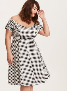"""It doesn't get much sweeter than this swing dress! The fitted bodice is flirtier than ever with off shoulder sleeves and slightly shirred details. The fitted waistband leads to a spinnable flared skirt.<div><ul><li style=""""list-style-position: inside !important; list-style-type: disc !important"""">Cotton fabric</li><li style=""""list-style-position: inside !important; list-style-type: disc !important"""">Off shoulder neck</li..."""
