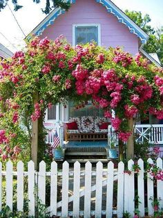 ♥Pink cottage, white picket fence,  arbor with climbing roses - could it be any better? Maybe it's ocean-view.