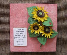 Quilled sunflowers on a pink panel