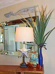 Beach House Bar Area - okay, the starfish lamp is a little weird, but I love that blue bottle with the tall fronds in it! Also the Key West bottle, which was said to hold bourbon.
