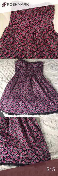 Black Poppy strapless floral dress Super cute summer dress with unexpected detail at tulle hem peeking from below skirt! Bodice has pretty fold-over detail. Fit and flare skirt. Boning at sides to keep shape, elastic back, back zip. Black Poppy Dresses