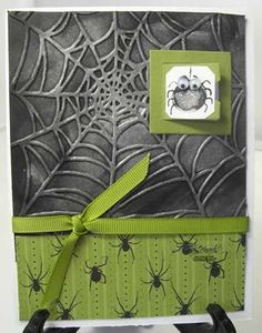 "Embossed spider web Halloween card. With spider ""wallpaper"" and ribbon."