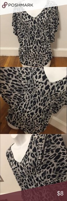 "Cute Leopard Print Shirt Isabella Rodriguez leopard print Tshirt with ""wing"" like sleeves, silk like material, loose fitting, and an elastic waist band. Very comfortable and cute. Great condition. Size medium. Isabella Rodriguez Tops Tees - Short Sleeve"