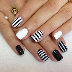 Classic black and white with a twist -- throw some orange or lime green or purple for halloween nails