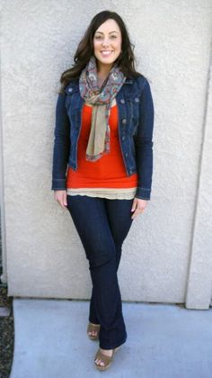 Flared jeans, bright shirt, wedges. I like that her jeans and the jacket are slightly different washes... It breaks up the monotony of the denim. I would probably wear flats instead of the wedges, but that's just me. ;)