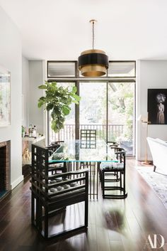 A fiddle leaf fig basks in a sunny spot in Goop VP Noora Raj Brown's Manhattan apartment | archdigest.com