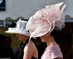 In bloom: A lady arrives in a large peony-inspired hat coloured a delicate blush…