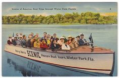 The Winter Park Boat Tours take passengers down the narrow canals that connect several of the lakes in the Winter Park, Florida area.  The old boats are gone now, replaced by modern pontoon boats.
