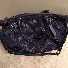 Beautiful navy large coach bag Beautiful leather bag!  Has navy color with c's emblem all over. Has handles and a shoulder strap. Inside is really roomy with a few small compartments. Coach. Has silver hardware and only wear is last picture. This bag is seriously perfect it holds so much and is soft so it doesn't feel stiff under your arm Coach Bags Shoulder Bags