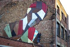 Artist Uses Discarded Doors to Create Giant Street Murals - My Modern Met