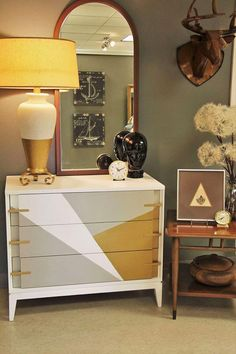 """We at GF are so happy to share this fun and exiting this dresser by Sondra Foust is!  """"Antiques don't always have to be stuffy, frilly, dated or chippy. They can be cool and trendy! This isn't your grandmas furniture anymore. It's young, trendy, and exciting,"""" Sondra explains. """"We painted this mid-century beauty with Snow White Milk Paint, Limestone Chalk Style Paint, and Burnished Pearl Effects with High Performance Topcoat Satin. We also updated this rather dated lamp with a Burnished…"""