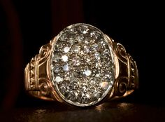 1890s Victorian Signet Ring with Art Deco Diamond Cluster Top10K Yellow, 14K White Gold, ~0.60ctw Single Cut Diamonds, $1950 This is a 19th century signet ring that was modified in the 1920-30s to have a cluster of diamonds on its face. It's quite well done, and quite a lot more spectacular in person than it is in this photo. It reminds me of pyrite rings we've had in the past, except than instead of fool's gold in the center, it's a big cluster of really nice diamon...
