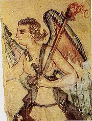 The Etruscan psychopomp Vanth, as depicted in a fresco in Etruscan tomb in Tarquinia.